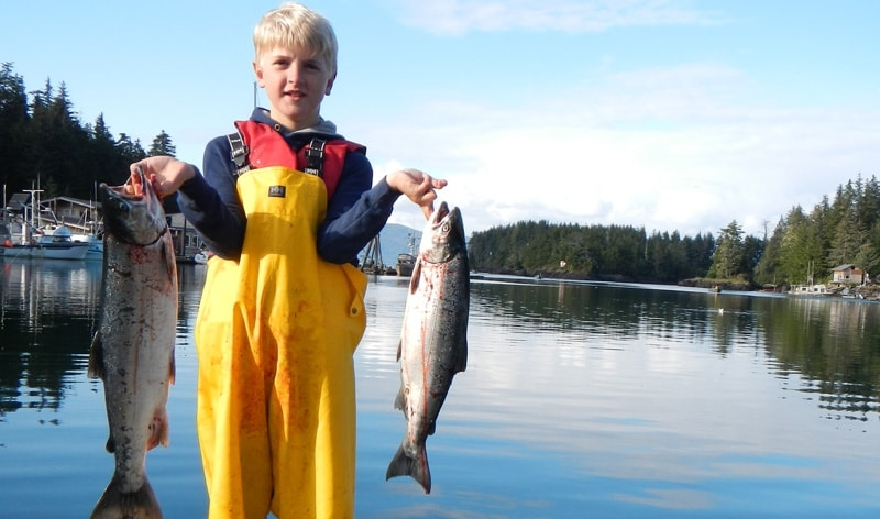 Young man with Alaskan Salmon